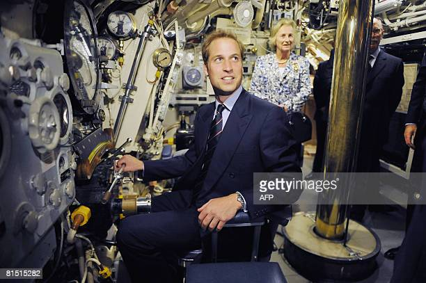 Britain's Prince William sits inside a submarine periscope during a visit to the Royal Navy Submarine Museum in Gosport south England on June 10 2008...