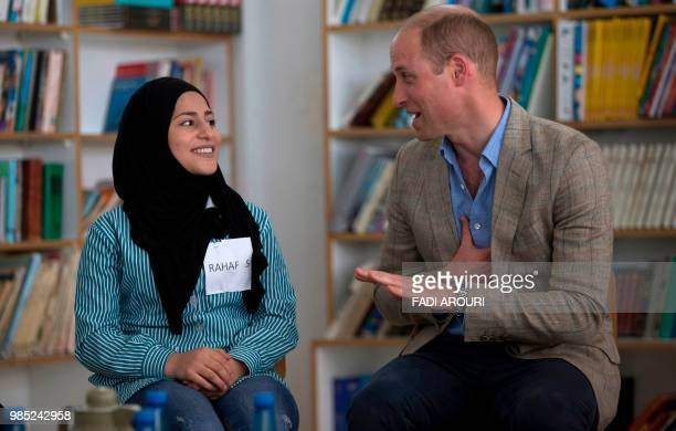 Britain's Prince William speaks with Palestinian students at a school operated by the UNRWA inside AlJalazoun refugee camp near the West Bank city of...