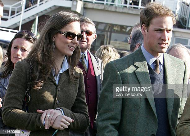 Britain's Prince William stands beside girlfriend Kate Middleton in the paddock enclosure on the first day of the Cheltenham Race Festival at...