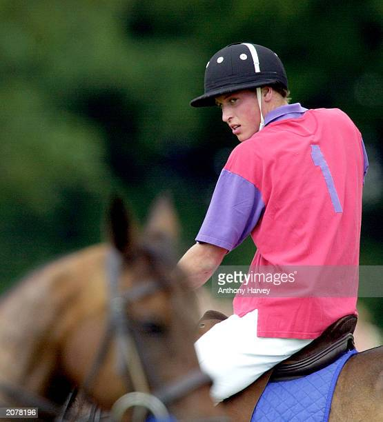 Britain's Prince William takes part in an exhibition Polo match July 15 2001 at Cirencester Park Polo Club in Gloucestershire England Prince William...
