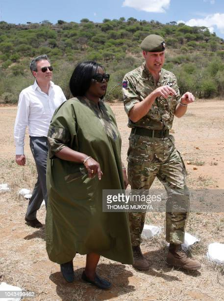 Britain's Prince William talks to Kenya's Defence Cabinet Secretary Rachael Omamo as British High Commissioner to Kenya Nic Hailey looks on during...