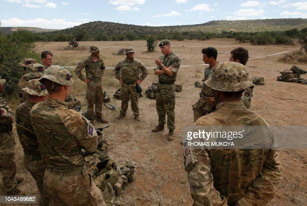 Britain's Prince William talks with Irish Soldiers during his visit to the 1st Battalion the Irish Guards Battle group training under the British...
