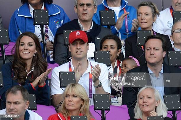 Britain's Prince William , the Duke of Cambridge and Catherine, Duchess of Cambridge and Britain's Prime Minister David Cameron attend the athletics...