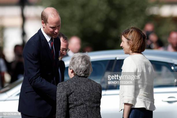 Britain's Prince William the Duke of Cambridge Britain's Prime Minister Theresa May and French Minister of the Armed Forces Florence Parlyleave after...