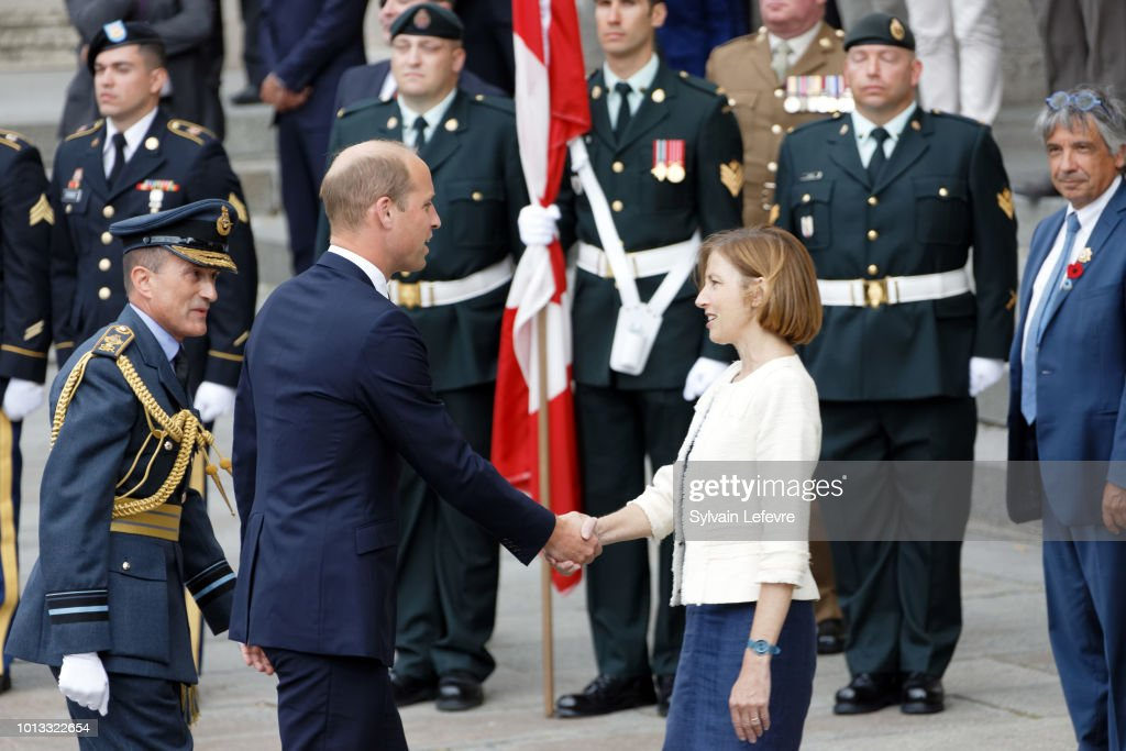 Britain's Prince William, the Duke of Cambridge, greets French Minister of the Armed Forces, Florence Parly, as Britain's Prime Minister Theresa May watches before a religious ceremony to mark the 100th anniversary of the World War I (WW1) Battle of Amiens, at the Cathedral on August 8, 2018 in Amiens, France.
