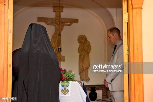 Britain's Prince William visits the grave of his greatgrandmother Princess Alice of Battenberg during a visit to the Mary Magdalene Church in east...