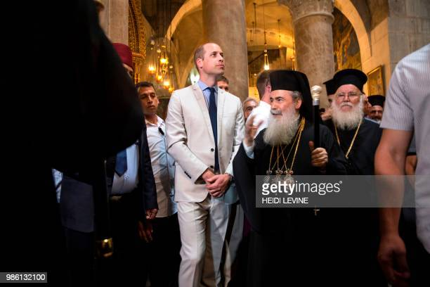 Britain's Prince William walks alongside Greek Orthodox Patriarch of Jerusalem Theophilos III as he visits the Church of the Holy Sepulchre in...