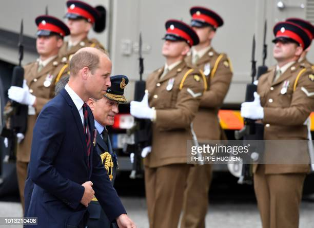 Britain's Prince William walks with officials in Amiens northern France on August 8 as he arrives to attend a ceremony to mark the 100th anniversary...