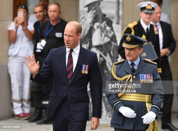 Britain's Prince William waves as he walks with officials in Amiens northern France on August 8 as he arrives to attend a ceremony to mark the 100th...