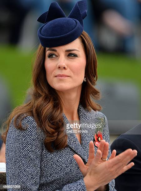 Britains Prince William's wife Catherine Duchess of Cambridge claps during the ANZAC Day march at the Australian War Memorial in Canberra on April 25...
