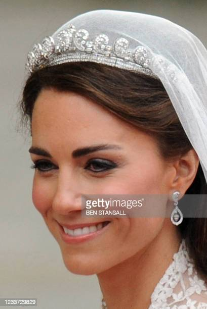 Britain's Prince William's wife Kate, Duchess of Cambridge, smiles as they travel in the 1902 State Landau carriage along the Processional Route to...