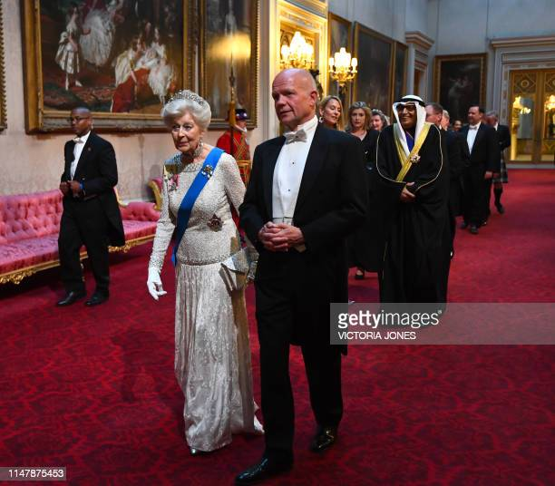 Britain's Princess Alexandra and former Foreign Minister William Hague arrive through the East Gallery during a State Banquet in the ballroom at...