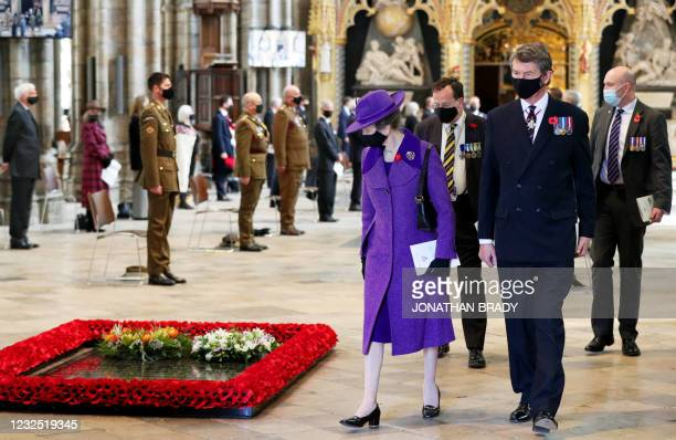 Britain's Princess Anne, Princess Royal and Vice Admiral Timothy Laurence pass the British grave of the Unknown Warrior after attending a service of...