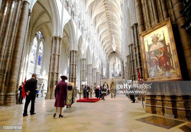 Britain's Princess Anne, Princess Royal and Vice Admiral Timothy Laurence arrive to attend a service of commemoration and thanksgiving to mark Anzac...
