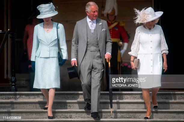 Britain's Princess Anne Princess Royal her brother Britain's Prince Charles Prince of Wales and his wife Britain's Camilla Duchess of Cornwall arrive...