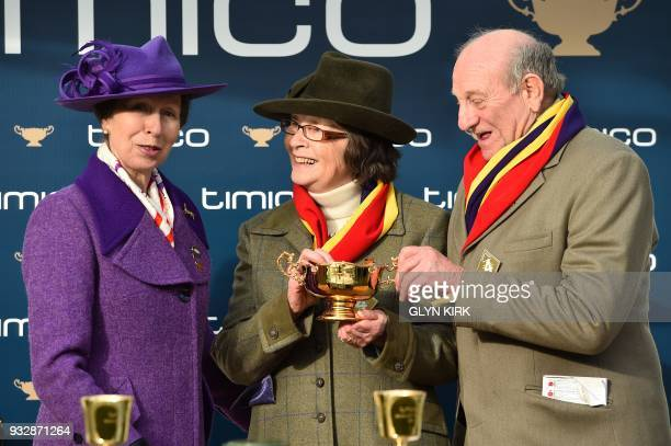 Britain's Princess Anne Princess Royal presents onwers Garth snd Anne Broom with the trophy after Jockey Richard Johnson rode Native River to win the...