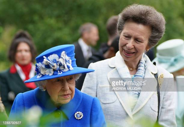 Britain's Princess Anne, Princess Royal speaks to Britain's Queen Elizabeth II during a visit to The Childrens Wood Project in Glasgow on June 30 as...