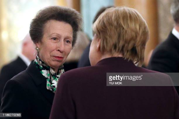 Britain's Princess Anne Princess Royal speaks with German Chancellor Angela Merkel at Buckingham Palace in central London on December 3 during a...