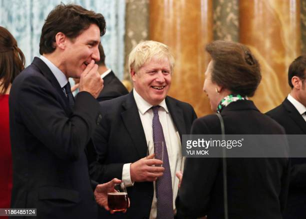 Britain's Princess Anne Princess Royal talks to Canadian Prime Minister Justin Trudeau and Britain's Prime Minister Boris Johnson during a reception...