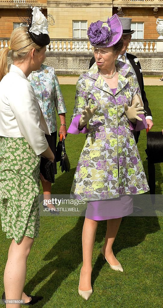 Britain's Princess Anne, Princess Royal (R), talks with guests during a garden party at Buckingham Palace, central London on May 28, 2015.