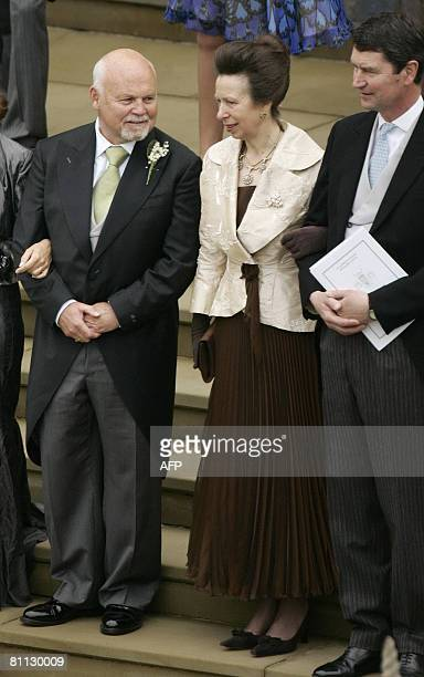 Britain's Princess Anne the Princess Royal mother of Peter Phillips and Commander Laurence talks to Brian Kelly father of Canadian Autumn Kelly as...
