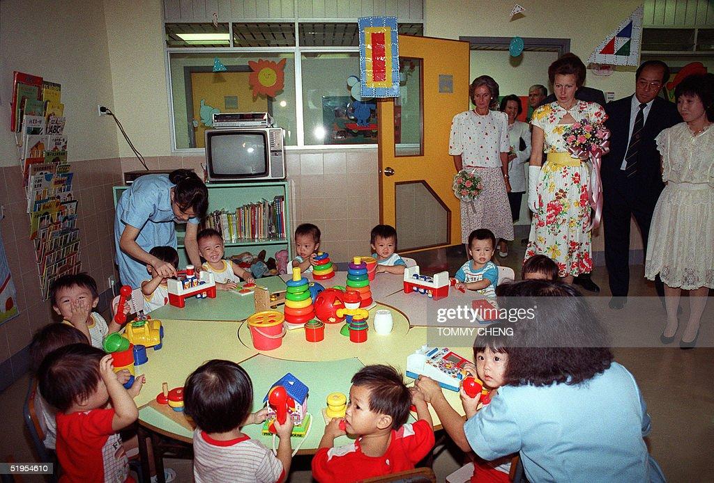 Britain's Princess Anne (3rd R) visits a nursery i : News Photo