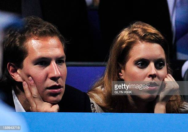 Britain's Princess Beatrice and boyfriend Dave Clark watches Rafael Nadal of Spain play against Roger Federer of Switzerland during their group B...