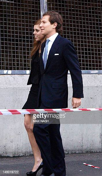 Britain's Princess Beatrice and her boyfriend Dave Clark arrive at the private party for the Clinton Foundation and Reuben Foundation in London on...