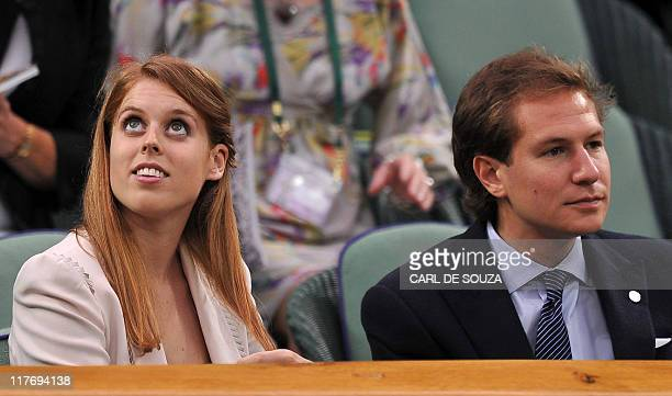 Britain's Princess Beatrice and her boyfriend Dave Clark attend the game between German player Sabine Lisicki and French player Marion Bartoli during...