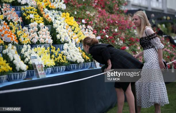 Britain's Princess Beatrice of York and Alice NaylorLeyland visit the 2019 RHS Chelsea Flower Show in London on May 20 2019 The Chelsea flower show...
