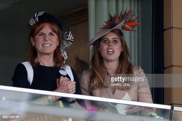Britain's Princess Beatrice of York and Sarah, Duchess of York react as they watch the King Edward VII Stakes on the fourth day of the Royal Ascot...