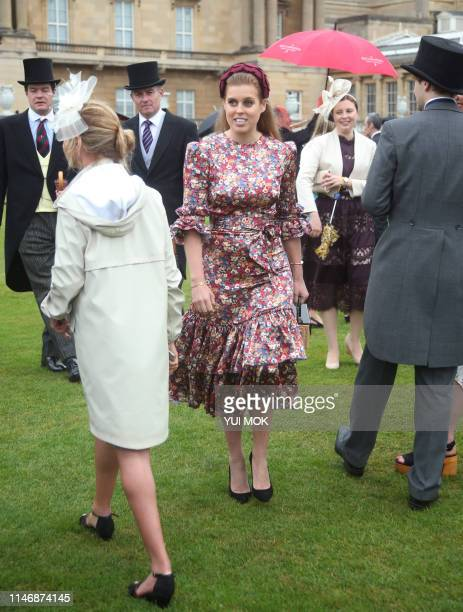 Britain's Princess Beatrice of York meets guests at the Queen's Garden Party in Buckingham Palace, central London on May 29, 2019.
