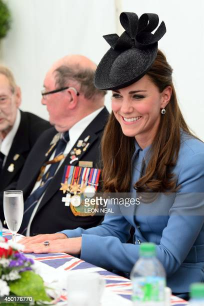Britain's Princess Catherine, Duchess of Cambridge, speaks to World War II veterans in Arromanches-les-Bains, on June 6 during an event commemorating...
