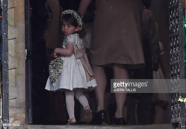 Britain's princess Charlotte, a bridesmaid, attends the wedding of her aunt Pippa Middleton to James Matthews at St Mark's Church in Englefield, west...