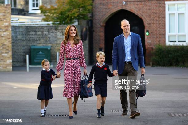 Britain's Princess Charlotte of Cambridge, accompanied by her father, Britain's Prince William, Duke of Cambridge, her mother, Britain's Catherine,...