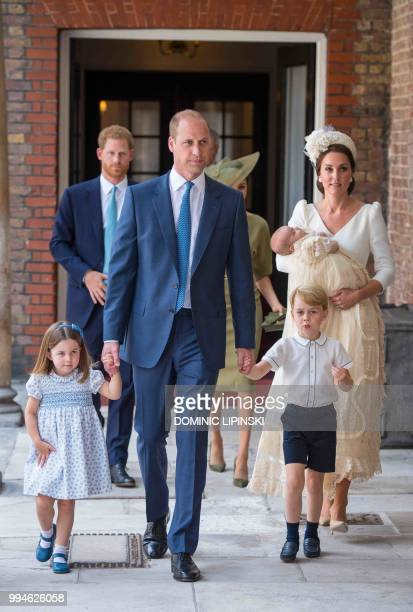 TOPSHOT Britain's Princess Charlotte of Cambridge and Britain's Prince George of Cambridge hold hands with their father Britain's Prince William Duke...