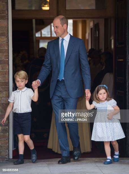 Britain's Princess Charlotte of Cambridge and Britain's Prince George of Cambridge hold hands with their father Britain's Prince William Duke of...