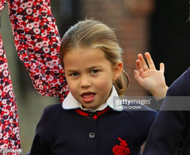 Britain's Princess Charlotte of Cambridge gestures as she arrives for her first day of school at Thomas's Battersea in London on September 5, 2019.