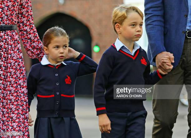 Britain's Princess Charlotte of Cambridge, with her brother, Britain's Prince George of Cambridge, arrives for her first day of school at Thomas's...