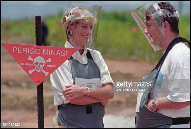 Britain's Princess Diana wearing a heavy duty protection vest and face shield is accompanied by a mineclearing expert of the Halo Trust 15 January...