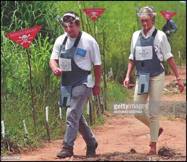 Britain's Princess Diana wearing a heavy duty protection vest and face shield is accompanied by a mine clearing expert during her visit to the...