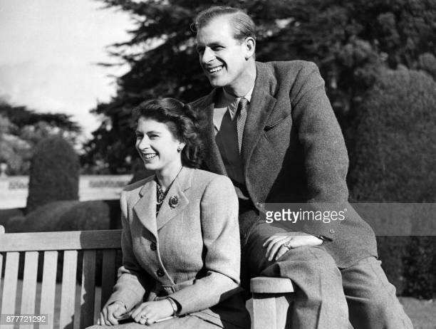 Britain's Princess Elizabeth and her husband Philip Duke of Edinburgh pose during their honeymoon November 25 1947 in Broadlands estate Hampshire