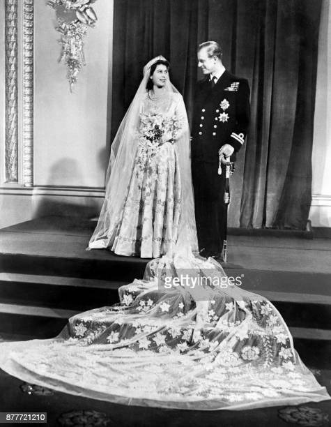Britain's Princess Elizabeth and Philip Duke of Edinburgh pose on their wedding day at Buckingham Palace in London on November 20 1947