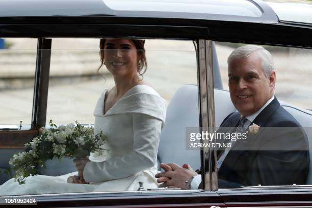 Britain's Princess Eugenie of York acompanied by her father Britain's Prince Andrew Duke of York arrives for her wedding to Jack Brooksbank at St...
