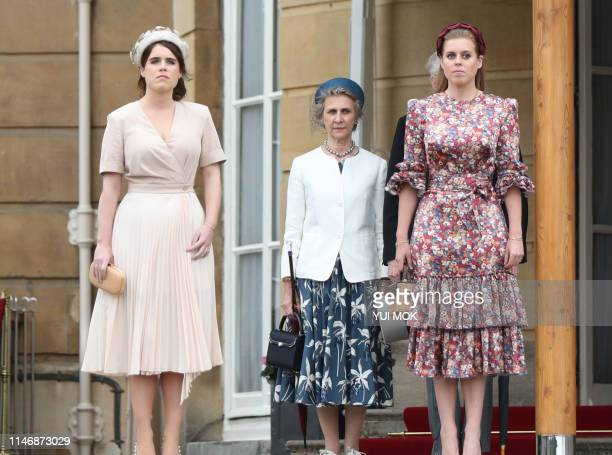 Britain's Princess Eugenie of York and Britain's Princess Beatrice of York arrive at the Queen's Garden Party at Buckingham Palace central London on...