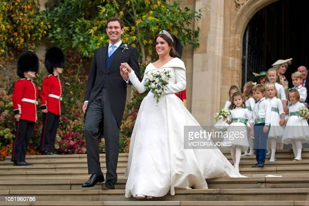 Britain's Princess Eugenie of York and her husband Jack Brooksbank emerge from the West Door of St George's Chapel Windsor Castle in Windsor on...