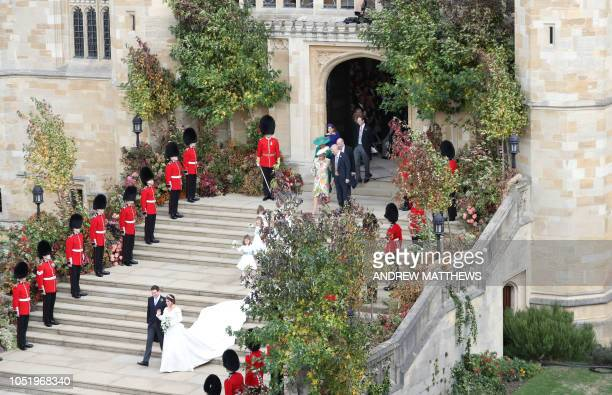 Britain's Princess Eugenie of York and her husband Jack Brooksbank emerge from the West Door of St George's Chapel, Windsor Castle, in Windsor, on...