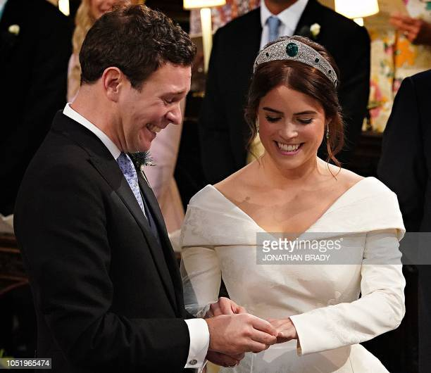 TOPSHOT Britain's Princess Eugenie of York and Jack Brooksbank are seen at the altar during their wedding ceremony at St George's Chapel Windsor...