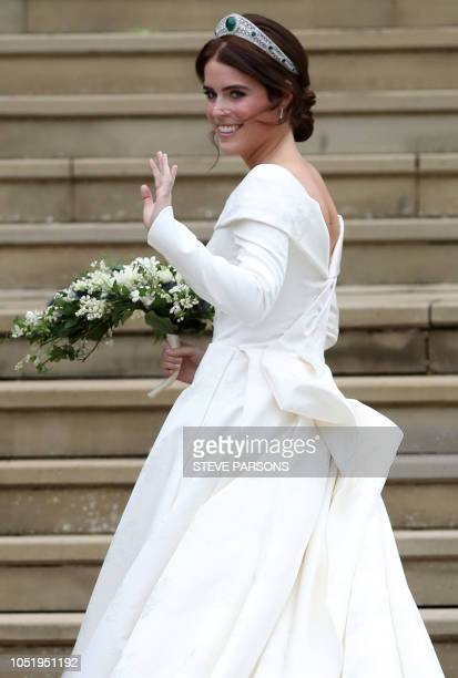 TOPSHOT Britain's Princess Eugenie of York arrives at the West Door of St George's Chapel Windsor Castle in Windsor on October 12 2018 for her...