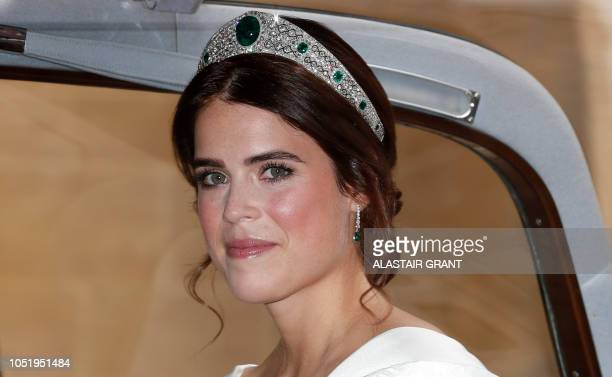 Britain's Princess Eugenie of York arrives to attend the wedding of Britain's Princess Eugenie of York to Jack Brooksbank at St George's Chapel...